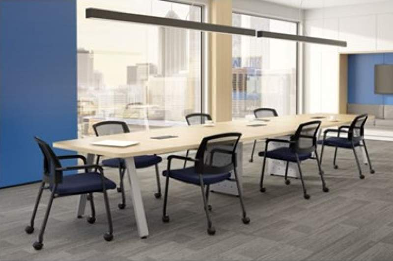 Large, long tan conference table