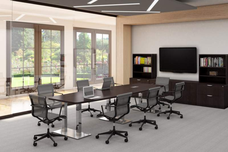 Medium sized dark brown conference table with a laptop on top